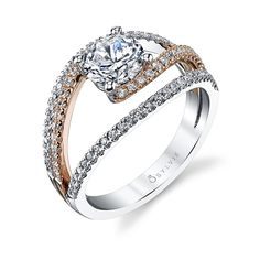 Style# S1194-TT Floating Style Engagement Ring With Two Tone Accent - An exquisite two tone accented engagement ring is created by the impression of a floating 1 carat round brilliant diamond center with a rose gold band accented with flowing diamonds on each side. https://www.sylviecollection.com/floating-style-engagement-ring-with-two-tone-accent-s1194-tt