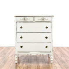 This cottage chic highboy dresser is featured in a solid wood with a distressed white paint finish. This tall dresser has 4 drawers, carved curved accents and a drop down desk with interior storage. Perfect as a drop down buffet bar! #shabbychic #dressers #talldresser #sandiegovintage #vintagefurniture
