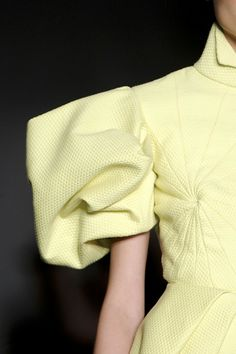 Pale yellow manipulated shoulder wear