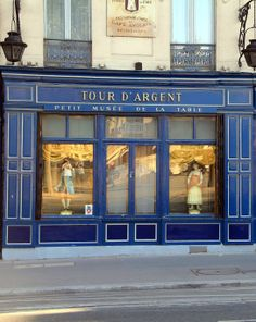 "I like how the outer transom windows are divided, but the middle one isn't."" Tour d'Argent, Restaurant, 15 Quai de la Tournelle, Paris V Paris Travel, France Travel, Rue Mouffetard, Shop Facade, Latin Quarter, Retail Merchandising, Paris Cafe, Paris Ville, I Love Paris"