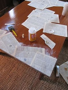 Table Makeover...Mod Podge Style..love the newspaper look