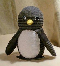 Pinguim feito com meia.