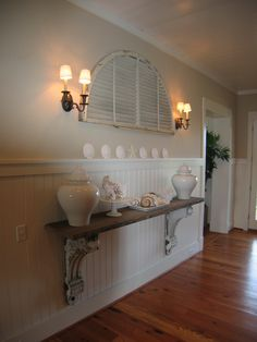 I like the shelf idea for a narrow foyer, where a piece of furniture may not be appropriate.