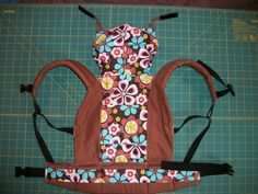 Awesome pattern for a kid doll carrier -- really close to an ergo!