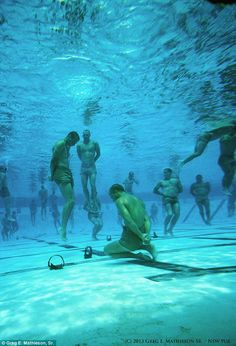 Navy SEALs underwater training.