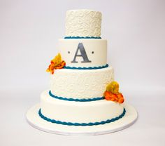 Bright borders and bouquets pop off the white base of this 4-tier