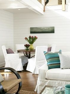 Crisp white, warm woods and splashes of color make this a lovely and appealing space.