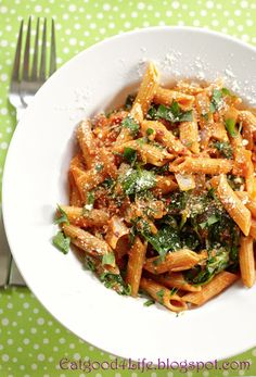 Yummy pasta with tomatoes, wine and spinach. You can use whole wheat pasta or gluten-free made with brown rice.