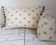 Check out this item in my Etsy shop https://www.etsy.com/uk/listing/543787840/bee-cushion-pompoms-cushion-cover