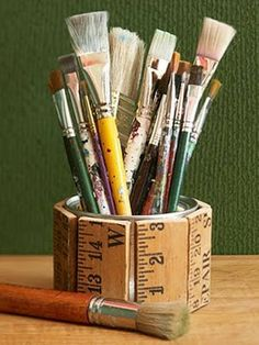 Love this idea of cutting a yardstick into pieces to then glue onto a can or container