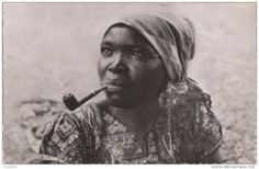 dynamicafrica:  Vintage portrait of a woman from Equatorial Guinea smoking a pipe
