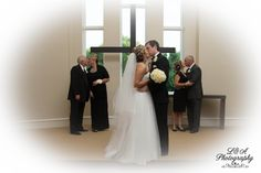 Love last Forever! Bride & Groom kissing while Bride's parents and Groom's parents kiss.