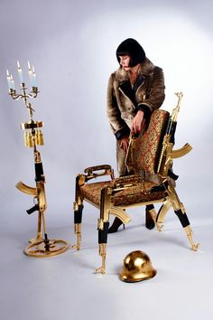 Designed by Artist, Rainier Weber, who got inspiration from a book he read about Michail Kalashnikov, this dramatic chair made … Chair, Ak 47, Artist, Lifestyle Fashion, Gold, Rifles, Inspiration, Design, Luxury