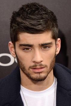 [b]The Year:[/b] August 2013 [b]The Look:[/b] The brooding popstar is back. Zayn Malik arrived at the New York premiere for [i]One Direction: This Is Us[/i] and went for a very natural, care-free look. We likey. Zayn Malik Style, Zayn Malik Photos, Latest Haircuts, Haircuts For Men, Undercut Hairstyles, Cool Hairstyles, Hairstyle Fade, 2014 Hairstyles, Hairstyle Short