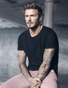David Beckham salmon pants, black crew neck.