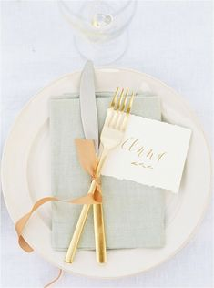 beautiful table setting -- cutlery tied with ribbon