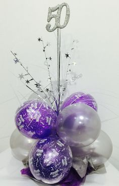 50th birthday balloon table centerpiece in purple and silver.