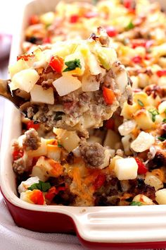 Perfect Breakfast Casserole - everything you love about breakfast in one easy and delicious casserole! Bacon, sausage, mushrooms, peppers, onions, hash browns, eggs and cheese. This breakfast bake is perfection!