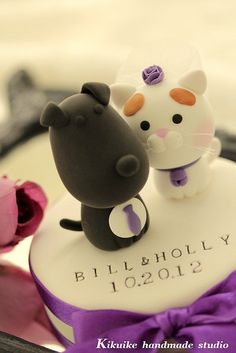 Lovely cat and dog Wedding Cake Topper by charles fukuyama, via Flickr