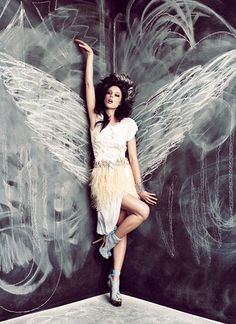 I thought this was really neat it looks as if she has wings...love that the drawing material chalk symbolizes her wings