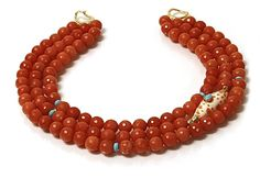 Helga Wagner Faceted coral color Agate with turqoise roundels and Mitra Papalis orange and white seashell with Turquoise cabochon set in 14k gold and tiffany clasp.  N503-41