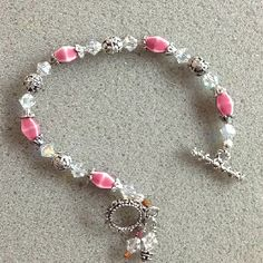 Pink glass beads, crystals, & silver
