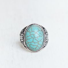 """Festival sale! Turquoise ring Accent your look with this bohemian-inspired ring. Featuring an oval turquoise stone, it's finished with intricate engravings at the sides. Imported 0.88"""" width Jewelry Rings"""