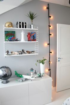 Or hang them from a hook in a kid's room for a modern nightlight. 19 Super Cozy Ways To Use String Lights In Your Home Deco Design, Bedroom Lighting, Wall Lighting, Boy Room, Child's Room, Kids Bedroom, Bedroom Ideas, Bedroom Balcony, Decorating Your Home