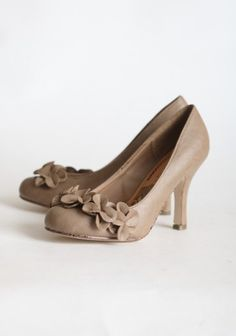 """Taupe 3.5"""" heels - looks neutral enough to wear with anything.  Very feminine and sweet with the flowers at the toe.  $32.99 (yay!)"""