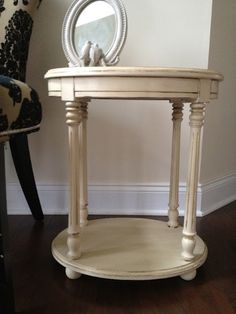 Column table in Old Ochre, dark wax and gold guilding on the legs.