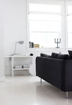 Stunning Scandinavian living space with Danish design furniture. Muuto Leaf lamp. black and white minimal style by AMM blog.
