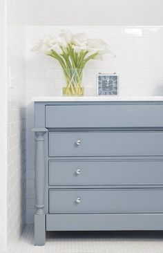 Cabinet painted in the color Eclipse from Benjamin Moore. Round up of 16 of the best furniture paint colors.