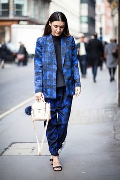 Anisa Sojka wearing blue Finders Keepers floral and striped matching blazer and trousers suit co-ords, black Finders Keepers high neck top, silver / gold / bronze Rebus OMG rings, blue fur See Me Bags pom pom, beige 3.1 Phillip Lim mini pashli cross-body bag and black Nly sandal heels. Fashion blogger street style shot in London by Cristiana Malcica.