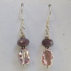 """Freshwater pearl and gemstone earrings. Natural color pink keishi pearls and faceted mauve agate roundels on sterling silver french hook ear wires. 1 3/4"""" long."""