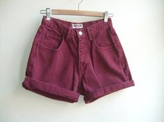 high waisted vintage cranberry denim shorts, is pair these with a button down, cable knit sweater over and some patterned tights with boots or booties.
