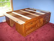 diy storage bed made from 2 dressers. Ikea malm dressers would be waaaayy nicer- there are tons of those on craigslist for cheap