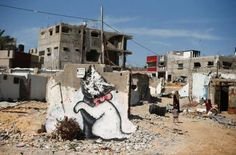 A mural of a kitten, presumably painted by British street artist Banksy, is seen on the remains of a... - SUHAIB SALEM/Newscom/Reuters