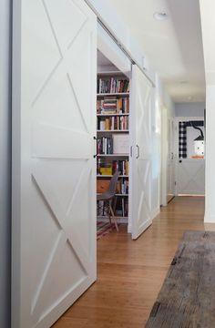Modern farm door in hallway leading to study