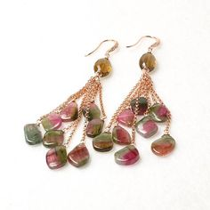 Everyone deserves a chance to shine! When it comes to looking your best, look no further than these beautiful earrings. At the end of the 14k ROSE gold filled rolo chains hang the bright bi-colored slices of tourmaline gemstone. It's a match made in heaven! The faceted Whisky Quartz