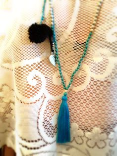 turquoise tassel wings necklace