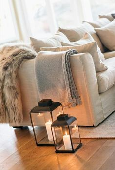 Lanterns on the floor of the living room -creates coziness.