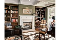 this is my idea of a library...plus, I love the combination of dark wood and white trim