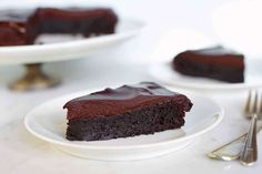 Rich, deep-dark flourless chocolate cake with chocolate-ganache glaze. add at least 5 minutes to the baking time for the middle of the cake to set. I do use their Dutch-process cocoa, but I use a pan instead of an Chocolate Low Carb, Best Chocolate Cake, Chocolate Flavors, Chocolate Ganache, Melting Chocolate, Chocolate Chips, Chocolate Recipes, Decadent Chocolate, Key Lime