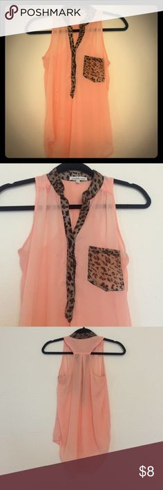 Flowing Pink and cheetah print shirt Love this shirt. It is sheer so may want to wear tank underneath. It buttons up to a v-neck and has cute pocket design on front. Charlotte Russe Tops