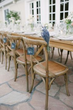 wedding reception chair decor idea using lavender and French bistro chairs; photo: Pictilio