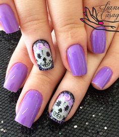 A really pretty skull inspired Purple nail art design.  Why not make a creative turn in your simple matte purple nail polish by drawing a freehand white and purple themed skull.