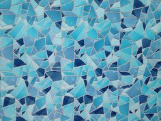 Detail view of Apple Store tile mosaic in Barcelona using colors from the Videos iOS app icon