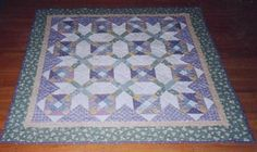 Bonnie K. Hunter wrote: Summer 1997 brought a special gift to our family! My brother and his wife made me an Auntie for the 4th time! I had been working on a mystery quilt with my sewing circle, and when I heard the news that the sweet baby girl had made her appearance, I knew right then that this quilt was just right for Jessica! This quilt is made with authentic and reproduction 1930's prints, and is machine pieced and machine quilted.