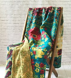 "Kantha Throw - Handcrafted by women at the co-op Basha in Bangladesh. Kantha, meaning 'patched cloth', offers a glimpse into the creativity and artistry of Bengali women.  Young women in Bangladesh are at great risk of being sold into trafficking and are often discarded by husbands or families when they are deemed ""expendable.""  Basha's vision is help these women rediscover their dignity and inherent value not only through meaningful work and by welcoming them as part of the Basha family."