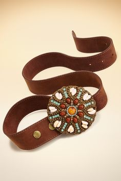 A dramatic rhinestone medallion accents this genuine leather skinny belt.